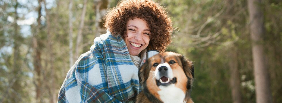 Young smiling woman with dog